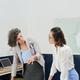 Entrepreneur Discussing Statistics Document - PhotoDune Item for Sale