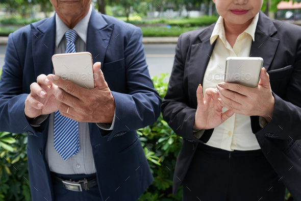 Business People Reading Notifications - Stock Photo - Images
