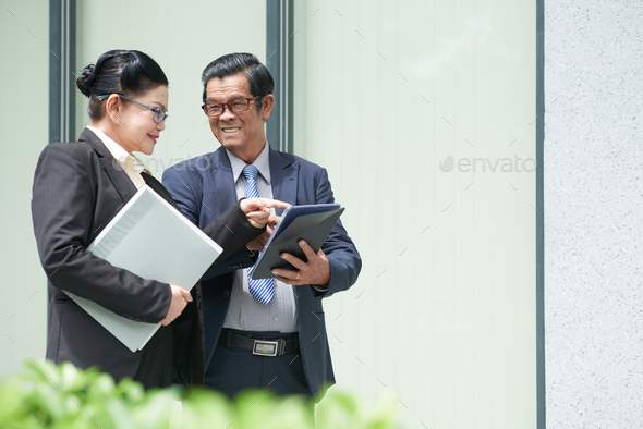 Entrepreneur Showing Contract to Colleague - Stock Photo - Images