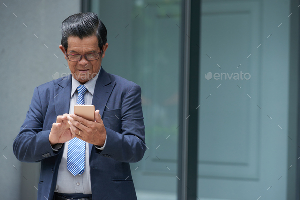 Entrepreneur Answering Text Messages - Stock Photo - Images