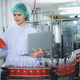 professional inspection control scientist in uniform are working for fruit juice production - PhotoDune Item for Sale