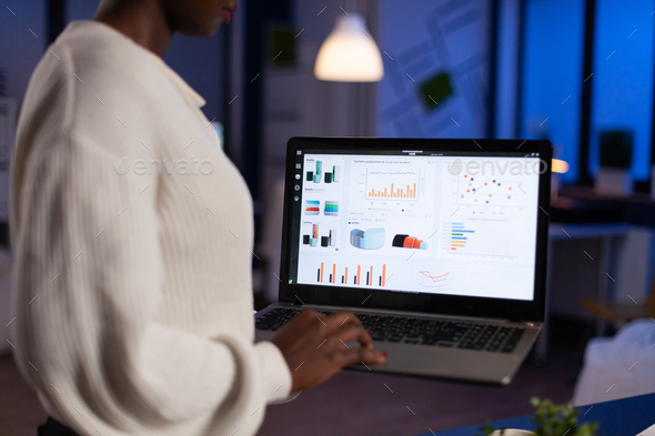 African american businesswoman holding laptop computer typing economic company profit - Stock Photo - Images