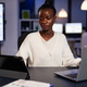 Workaholic tired multitasking african american entrepreneur analyzing financial graphs - PhotoDune Item for Sale