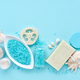 Sea salt, cream, soap, sponges and shells in cosmetics set for spa on blue background - PhotoDune Item for Sale