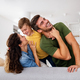 Happy family. Beautiful young parents having fun, playing with their son at home - PhotoDune Item for Sale