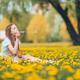 Little blonde girl pick flowers in a meadow full of yellow dandelions - PhotoDune Item for Sale