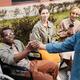 Making handshake with man in wheelchair - PhotoDune Item for Sale