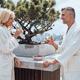 Beautiful mature couple in bathrobes enjoying fruits and wine - PhotoDune Item for Sale