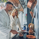 Beautiful mature couple in bathrobes preparing coffee together - PhotoDune Item for Sale