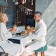 Beautiful mature couple in bathrobes enjoying breakfast together - PhotoDune Item for Sale
