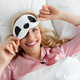 Portrait of happy lady lying in comfortable bed, wake up in morning, have fun, making funny face - PhotoDune Item for Sale