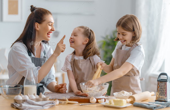 family are preparing bakery together - Stock Photo - Images