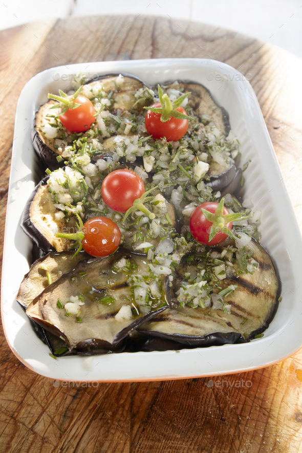 Grilled aubergines flavored with rosemary, olive oil and garlic - Stock Photo - Images
