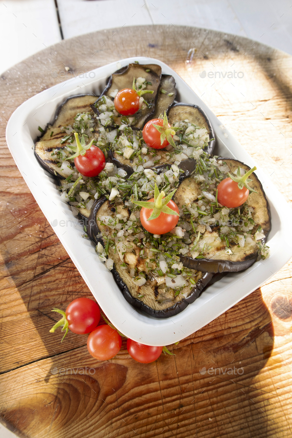 Grilled aubergines flavored with rosemary olive oil and garlic - Stock Photo - Images