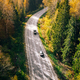 Aerial view of fall road and car through the autumn forest - PhotoDune Item for Sale