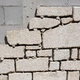 Detail of Cinder block wall being lined with granite stone slabs - PhotoDune Item for Sale