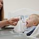 Giving Spoon Of Baby Food - PhotoDune Item for Sale