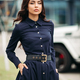 Beautiful woman in dark blue dress with hands in pockets - PhotoDune Item for Sale