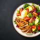Grilled chicken with fresh salad at black table - PhotoDune Item for Sale