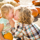 Sweet Little Boy Plays with His Baby Sister in a Rustic Ranch Setting at the Pumpkin Patch. - PhotoDune Item for Sale