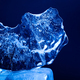 Block of ice on dark blue background. Frozen water abstract shapes. Macro view. - PhotoDune Item for Sale