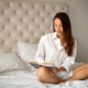 Beautiful young woman relaxing reading book at home - PhotoDune Item for Sale