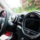 Steering wheel of city car. Small car for cities. - PhotoDune Item for Sale