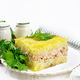 Casserole with potatoes and fish in plate on light table - PhotoDune Item for Sale