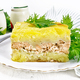 Casserole with potatoes and fish in plate on wooden board - PhotoDune Item for Sale