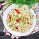 Fettuccine with zucchini and hot peppers in plate on board top - PhotoDune Item for Sale