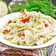 Fettuccine with zucchini and hot peppers in plate on dark board - PhotoDune Item for Sale