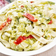 Fettuccine with zucchini and hot peppers in plate on dark wooden board - PhotoDune Item for Sale