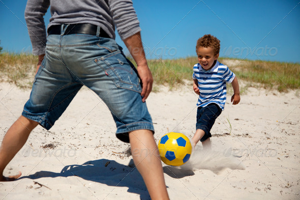 Father and Son Enjoying Football Game - Stock Photo - Images