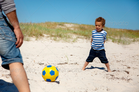 Little Kid Playing Football with Dad - Stock Photo - Images