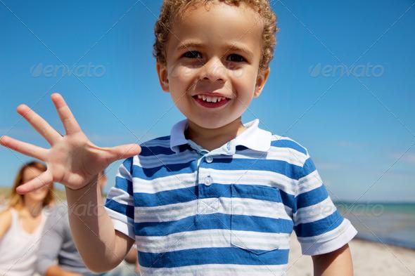 Closeup of a Little Kid Enjoying Outdoors - Stock Photo - Images