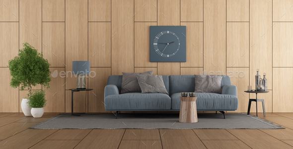 Wooden paneling in a modern living room with sofa - Stock Photo - Images