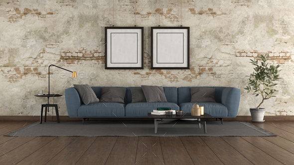 Modern blue sofa in a old room - Stock Photo - Images