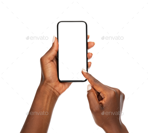 Black woman hands using smart phone on white background - Stock Photo - Images