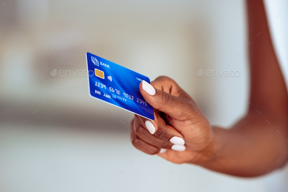 Black woman hand holding credit card - Stock Photo - Images