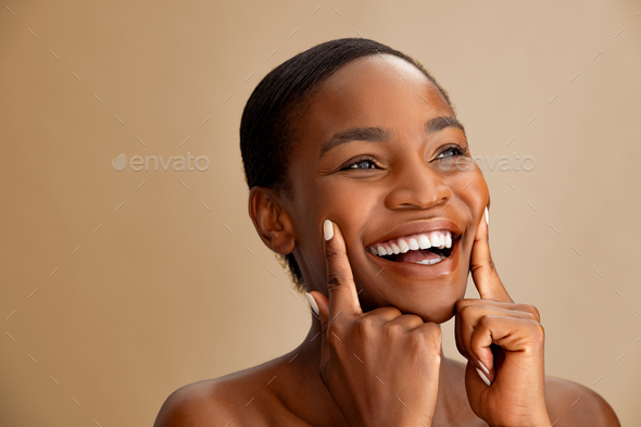 Happy mature african woman laughing - Stock Photo - Images