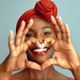 Black mature woman making heart shape and smile - PhotoDune Item for Sale