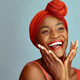 Laughing african american woman wearing red headband - PhotoDune Item for Sale