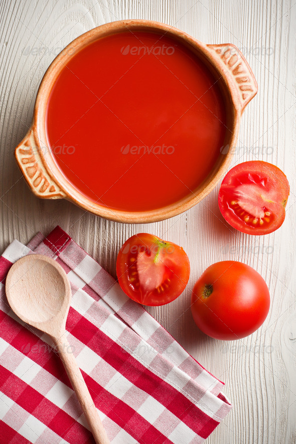 tomato soup on kitchen table - Stock Photo - Images
