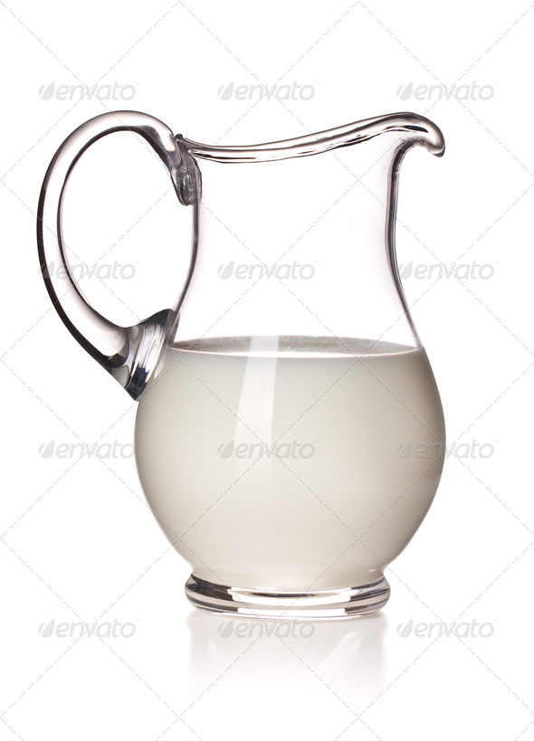 milk in a glass pitcher - Stock Photo - Images