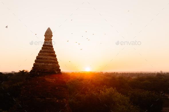 Buddhist temple shape against sun light during sunrise. - Stock Photo - Images
