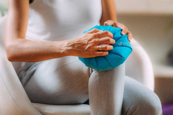 Knee Pain Cold Compress Ice Bag Treatment. - Stock Photo - Images