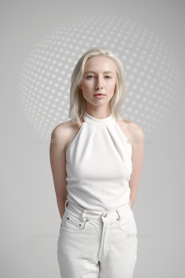 Futuristic young woman in white clothes - Stock Photo - Images