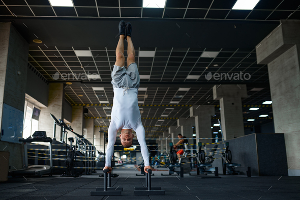 Strong man doing exercise, fitness training in gym - Stock Photo - Images