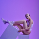 Model in futuristic glasses lying on cubes - PhotoDune Item for Sale