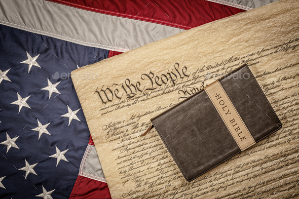 Holy bible on constitution and American Flag - Stock Photo - Images